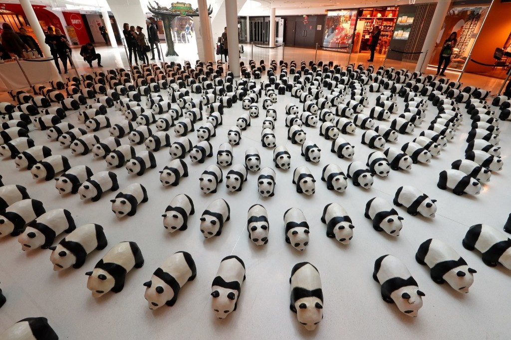 Papier-mache pandas at a shopping mall in Paris. Approximately 1,600 panda sculptures were displayed in the exhibition to remind people of the similar number of giant pandas still living in the wild. REUTERS/Benoit Tessier