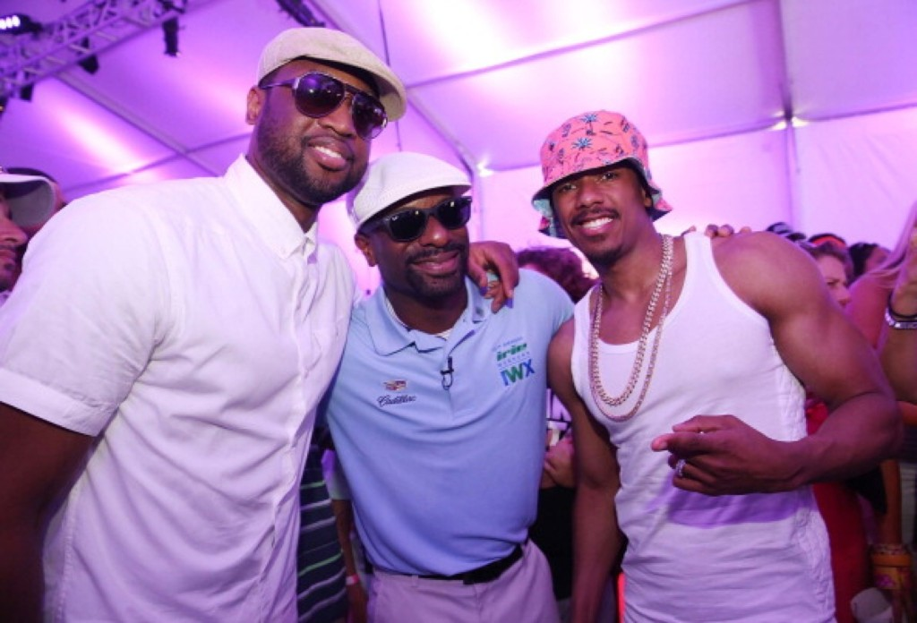 Dwyane Wade, DJ Irie and Nick Cannon attend a celebrity golf tournament in Miami Beach. Aaron Davidson/Getty Images