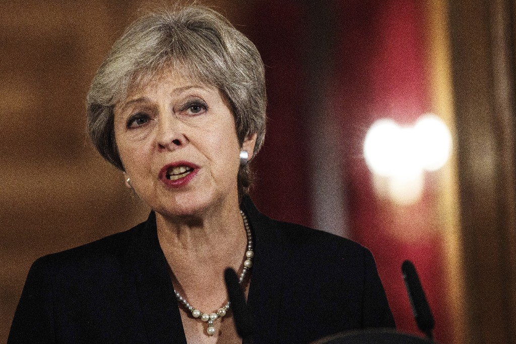 UK leader May hits back on Brexit plan; pound falls