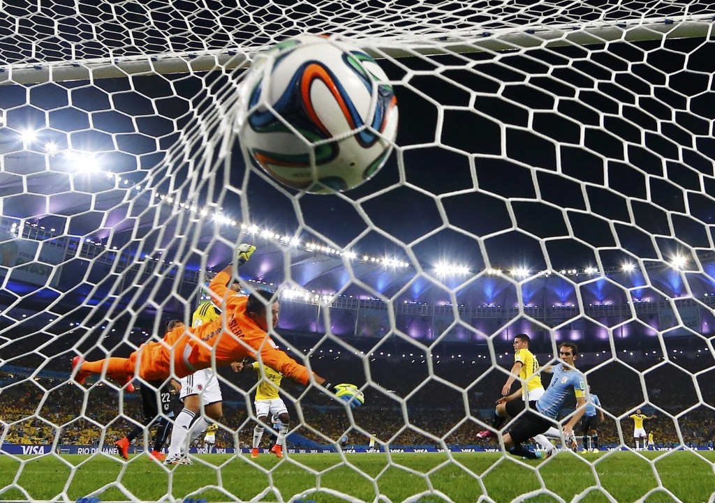 Uruguay's goalkeeper Fernando Muslera concedes second goal scored by Colombia's James Rodriguez. REUTERS/Michael Dalder