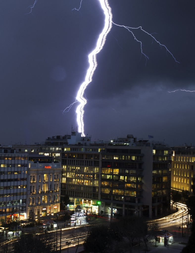 Lightning strikes over Syntagma square during heavy rainfall in Athens. REUTERS/Marko Djurica