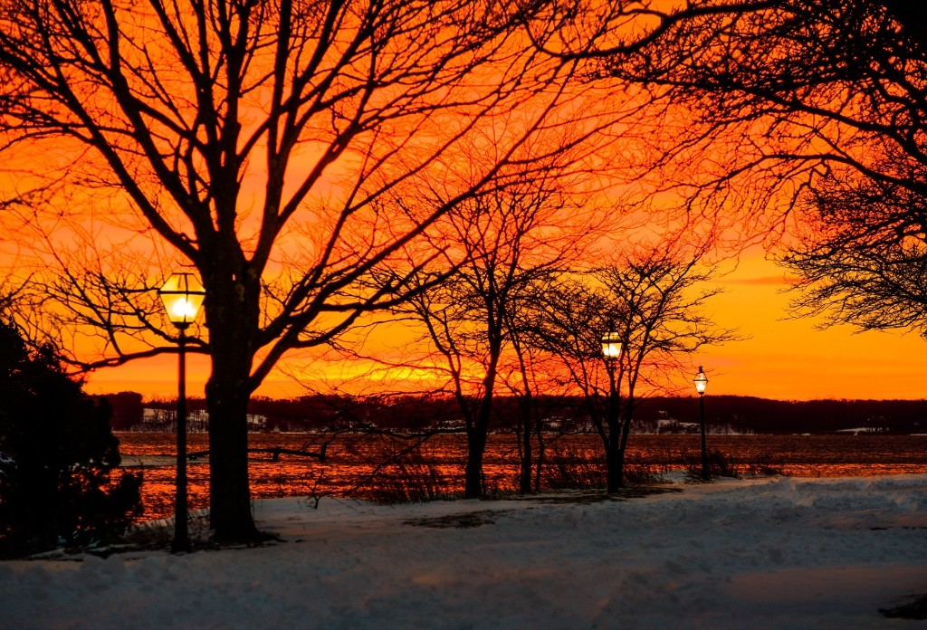The sun sets over Long Island Sound after a severe winter storm passed through the area. Andrew Theodorakis/Getty Images