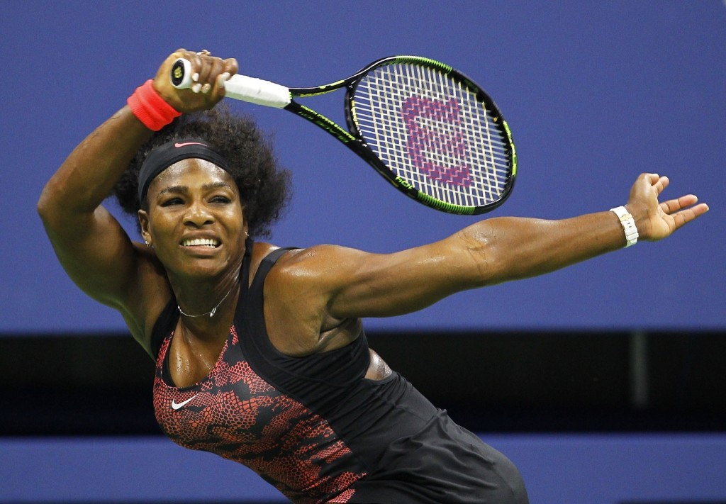 Serena Williams of the U.S. hits a return to her sister Venus Williams at the U.S. Open tennis tournament in New York, Tuesday. Gary Hershorn/Corbis