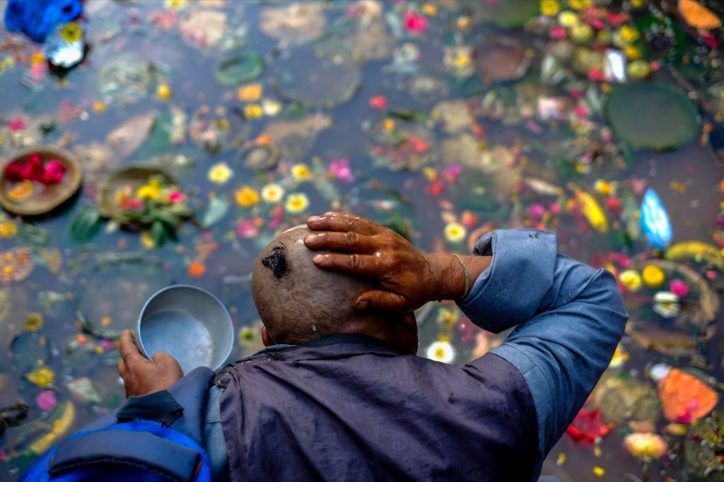 A Nepalese man washes his head before performing ruitals during Matatritha Aunsi, or Mothers Day, in Kathmandu. Sunil Pradhan/Anadolu Agency/Getty Images