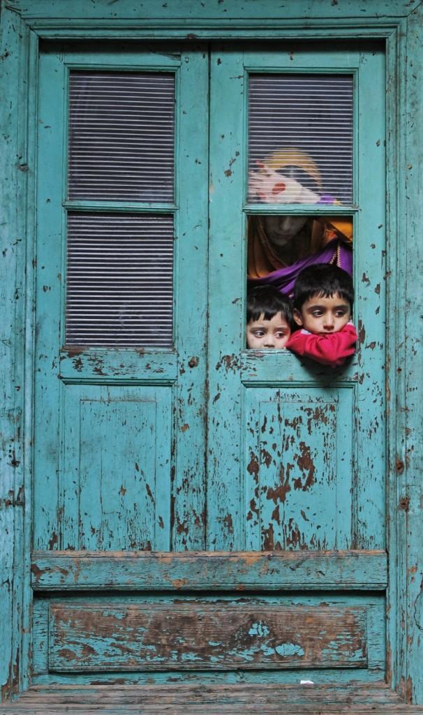 Kashmiri Muslims watch as a sheep is sacrificed during Eid al-Adha in Srinagar, India. AP Photo/Mukhtar Khan