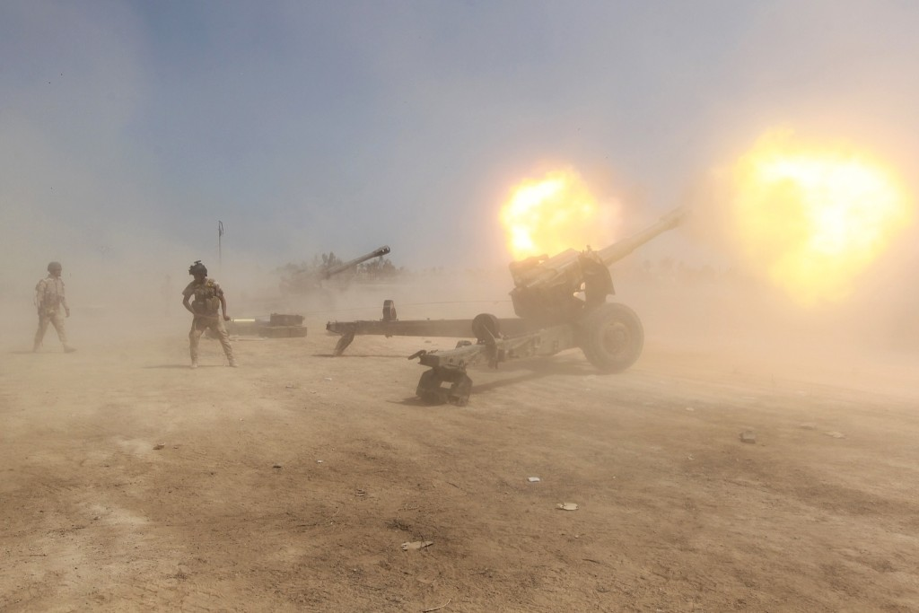 Iraqi forces fire artillery towards ISIS positions in the Garma district of Baghdad. AHMAD AL-RUBAYE/AFP/Getty Images