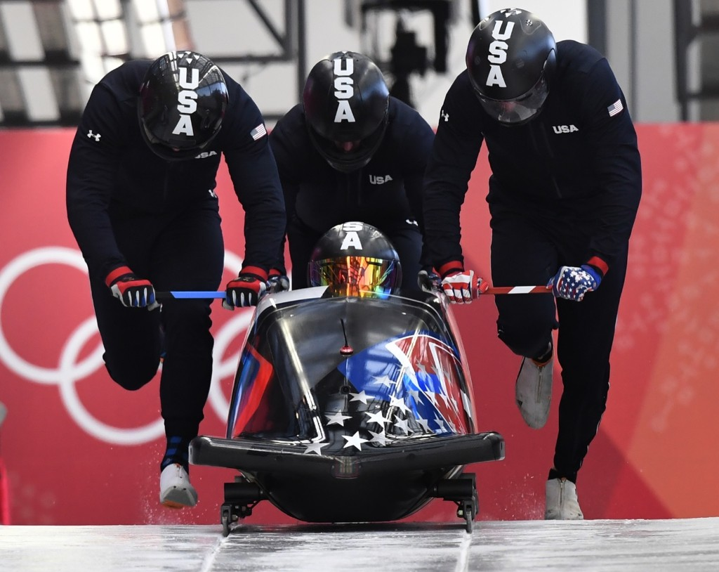 Pilot Codie Bascue of the US leads his team at the start of the four-man bobsleigh training session. MARK RALSTON/AFP/Getty Images
