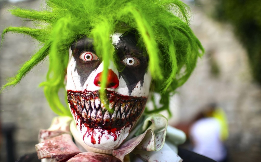 "A man dressed as a horror clown before a ""monster casting"" at the Filmpark Babelsberg theme park in Potsdam, Germany. REUTERS/Hannibal Hanschke"