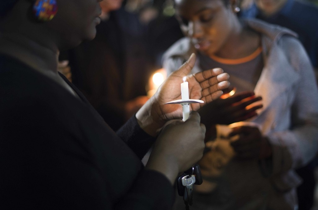 Peaceful protesters stand with candles outside North Charleston City Hall after the latest in a series of police killings of black suspects was caught on video. JIM WATSON/AFP/Getty Images