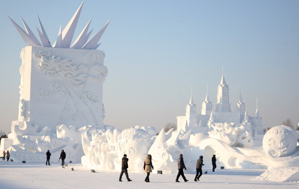 Workers put the finishing touch to a sculpture prior to the Harbin Sun Island International Snow Sculpture Art Expo. ChinaFotoPress/Getty Images