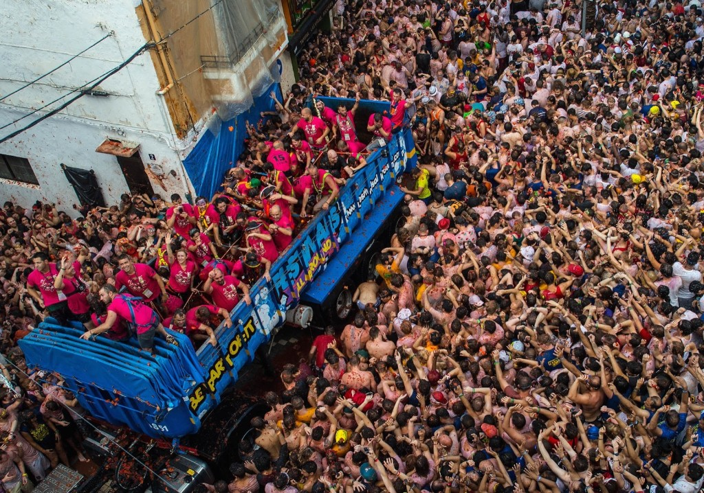 Revellers enjoy the atmosphere in tomato pulp while participating the annual Tomatina festival, Wednesday in Bunol, Spain. David Ramos/Getty Images