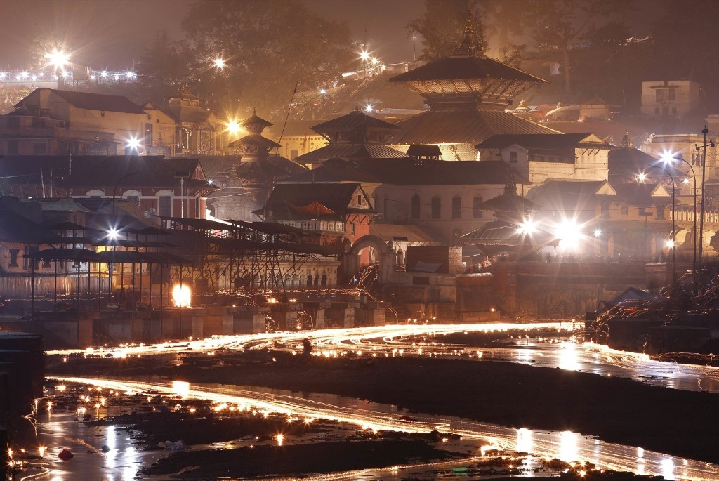 Oil lamps offered by devotees illuminate the Bagmati River flowing through the Pashupatinath Temple during the Bala Chaturdashi festival in Kathmandu. REUTERS/Navesh Chitrakar