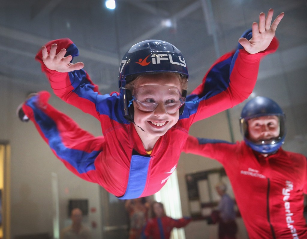David Schnaible teaches wind tunnel flying to nine-year-old Liam Harrison at the iFly indoor skydiving facility in Rosemont, Illinois. Scott Olson/Getty Images