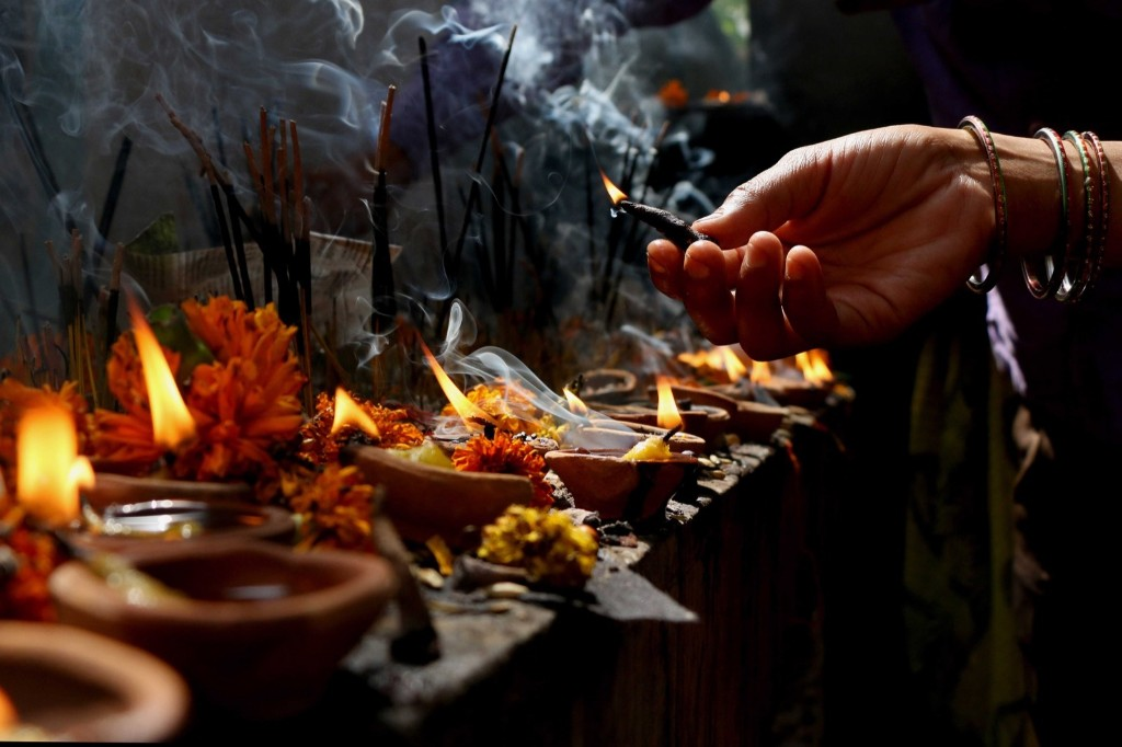 Performing prayers during Shani Amavasya at Shani Mandir in Noida, India. Salman Ali/Hindustan Times/Getty Images