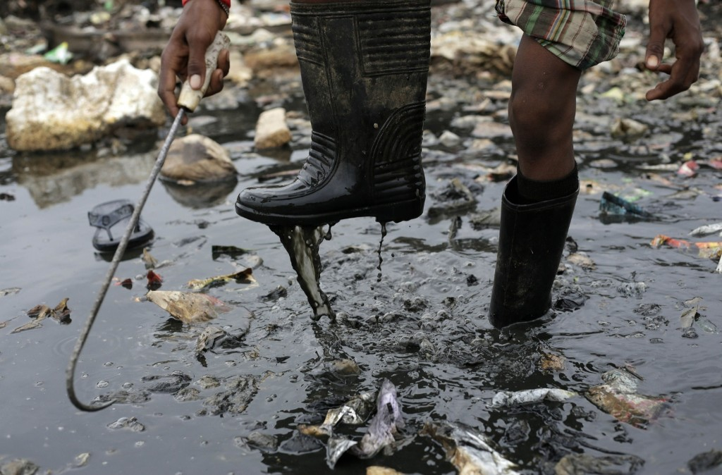 A boy looks for recyclable materials at a garbage dump on World Environment Day in Gauhati, India. AP Photo/Anupam Nath
