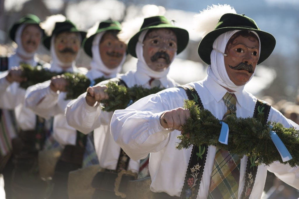 Costumed participants wearing traditional wooden masks perform in the annual carnival parade in Mittenwald, Germany. Philipp Guelland/Getty Images