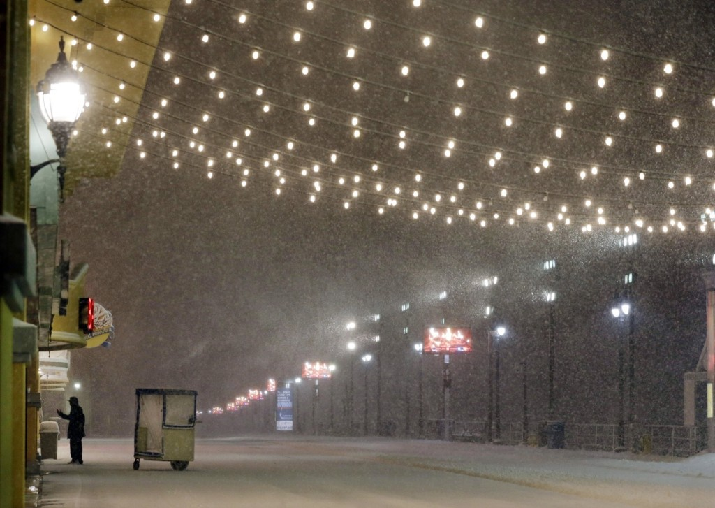A man and his pushcart during a snowstorm early Saturday on the Atlantic City Boardwalk. AP Photo/Mel Evans