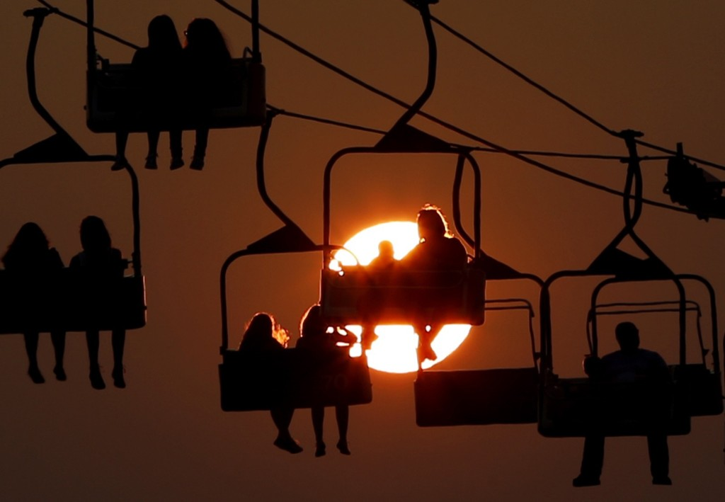 The sun sets behind a ride at the State Fair Meadowlands in East Rutherford, N.J. AP Photo/Julio Cortez