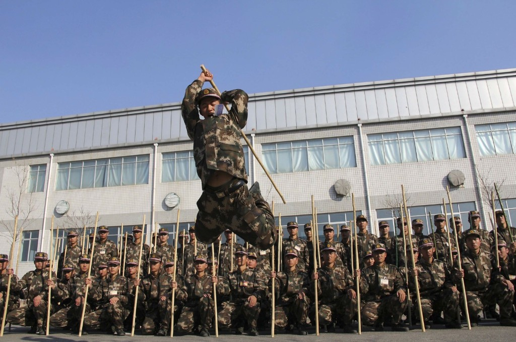 A newly-recruited paramilitary policeman participates in a drill in Hohhot, Inner Mongolia Monday. REUTERS/China Daily