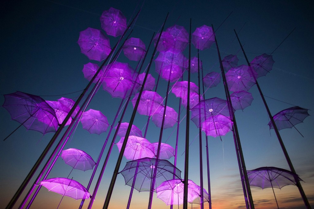"""Umbrellas"", a sculpture by Giorgos Zogolopoulos, is illuminated in pink light to mark Breast Cancer Awareness Month in Thessaloniki. REUTERS/Alexandros Avramidis"