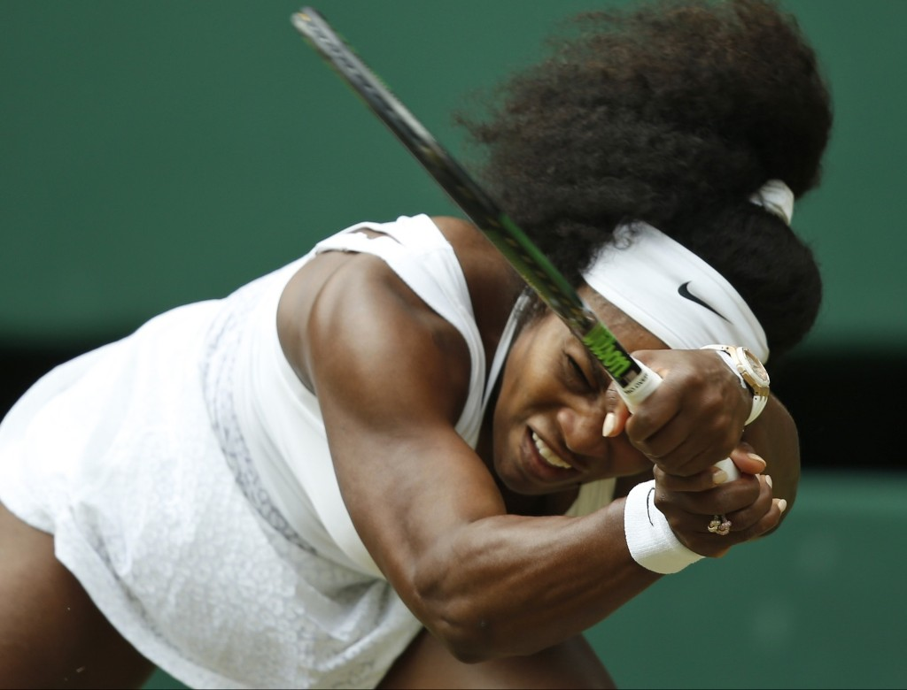 Serena Williams makes a return to Venus Williams. AP Photo/Alastair Grant