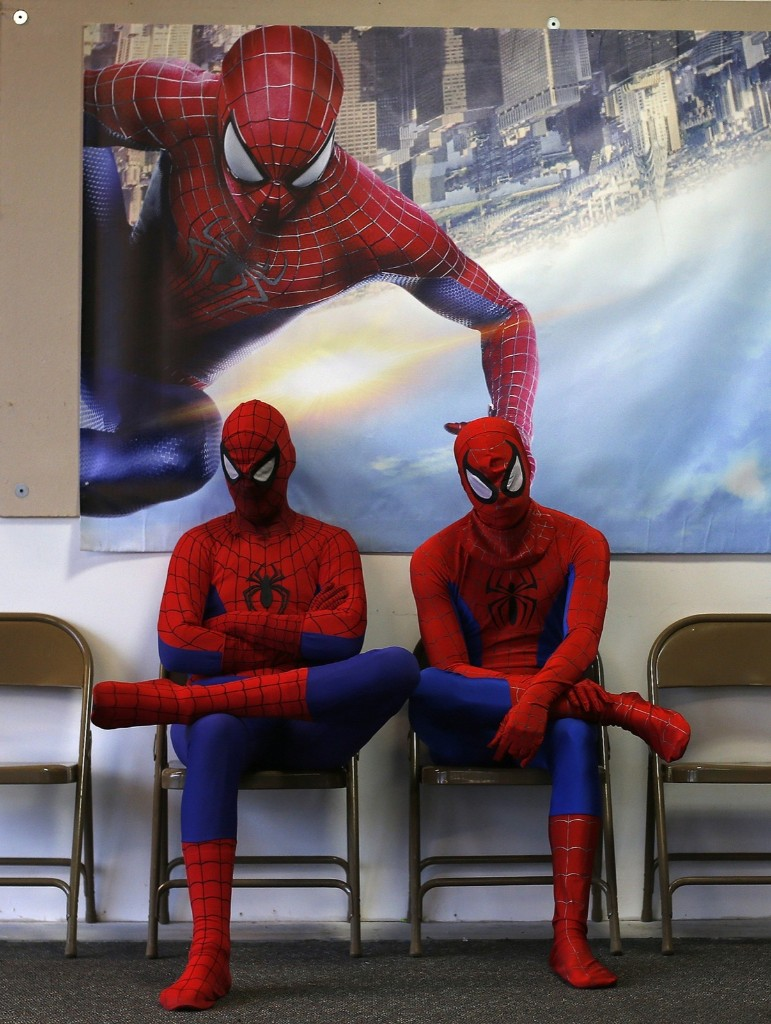 "Peter Norbot and Kris Hamilton wait to audition for a promotional campaign for the movie, ""The Amazing Spider-Man 2"", in Chicago. REUTERS/Jim Young"