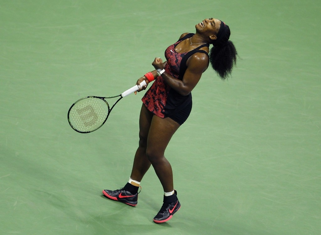 Serena Williams of the U.S. celebrates celebrates a point in her match against sister Venus Williams at the U.S. Open tennis tournament in New York, Tuesday. Gary Hershorn/Corbis