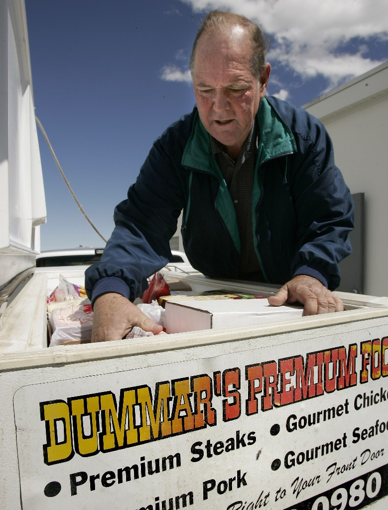 In this April 19, 2007 file photo, Melvin Dummar loads up with product from a meat packing company in Tooele, Utah. Dummar, a delivery driver who falsely claimed that billionaire Howard Hughes left a handwritten will bequeathing him $156 million, has died in rural Nevada. Nye County Sheriff Sharon Wehrly said Dummar died Sunday, Dec. 9, 2018, under hospice care. He was 74. (AP Photo/Douglas C. Pizac, File)