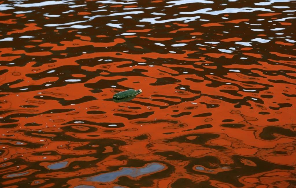 A bottle floats near a bridge on the Sava river in Belgrade. AP Photo/Darko Vojinovic