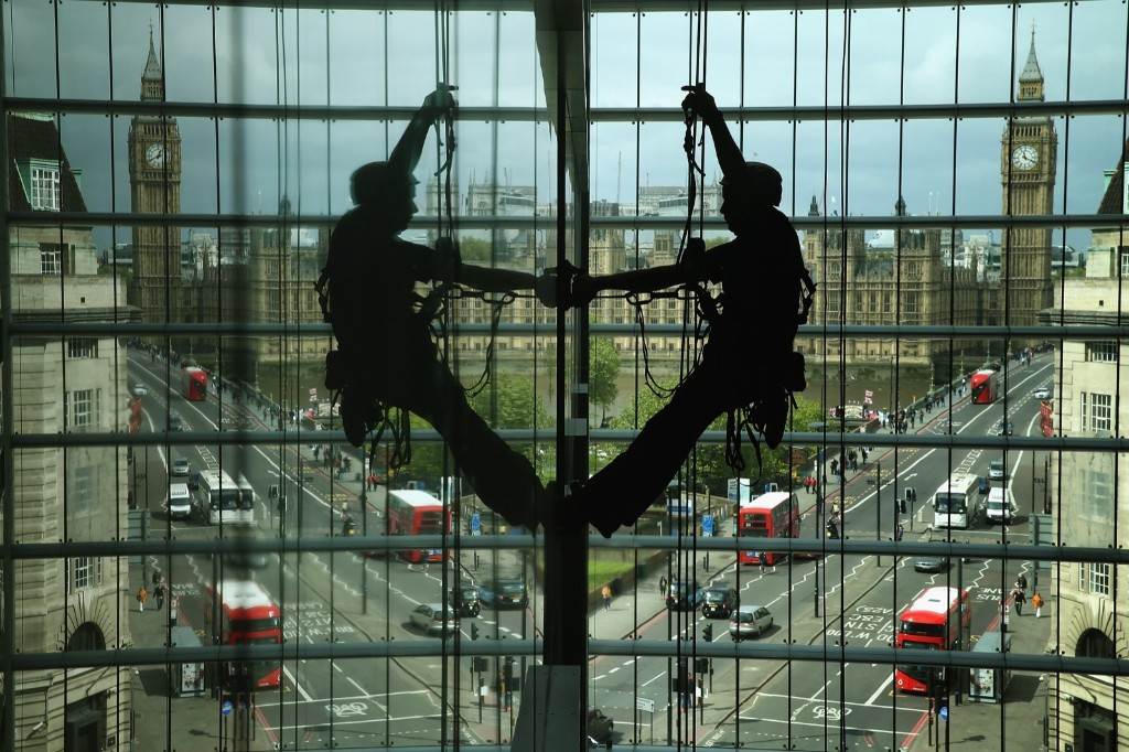 With the Houses of Parliament and Westminster Bridge in the background, a worker uses a climbing rope to scale and repair a wall inside the Park Plaza Westminster Bridge Hotel. Chip Somodevilla/Getty Images