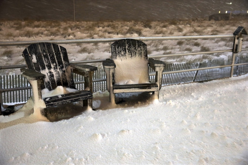 Snow builds up on two chairs on the Boardwalk early Saturday, in Atlantic City. AP Photo/Mel Evans