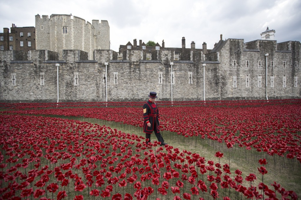 An installation entitled 'Blood Swept Lands and Seas of Red' by artist Paul Cummins, made up of 888,246 ceramic poppies at the Tower of London, to commemorate WWI. Oli Scarff/Getty Images
