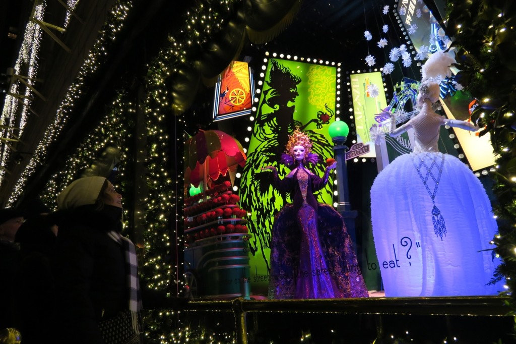 Snow White being tempted by an evil apple merchant in the heart of Times Square, at Saks. Photo by Gary Hershorn