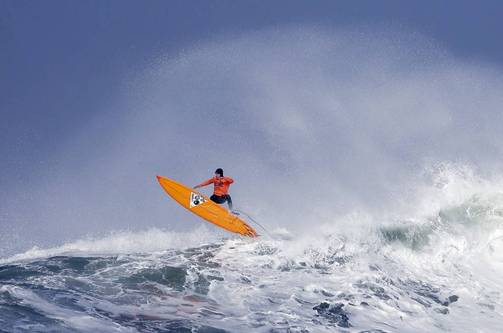 Tyler Fox flies out of a wave during the first round. AP Photo/Eric Risberg