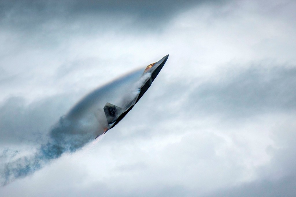 """U.S. Air Force Major Paul """"Loco"""" Lopez performs in an F-22 Raptor during an air show at Joint Base Langley-Eustis, Virginia. U.S. Air Force/Staff Sgt. Areca T. Bell via REUTERS"""
