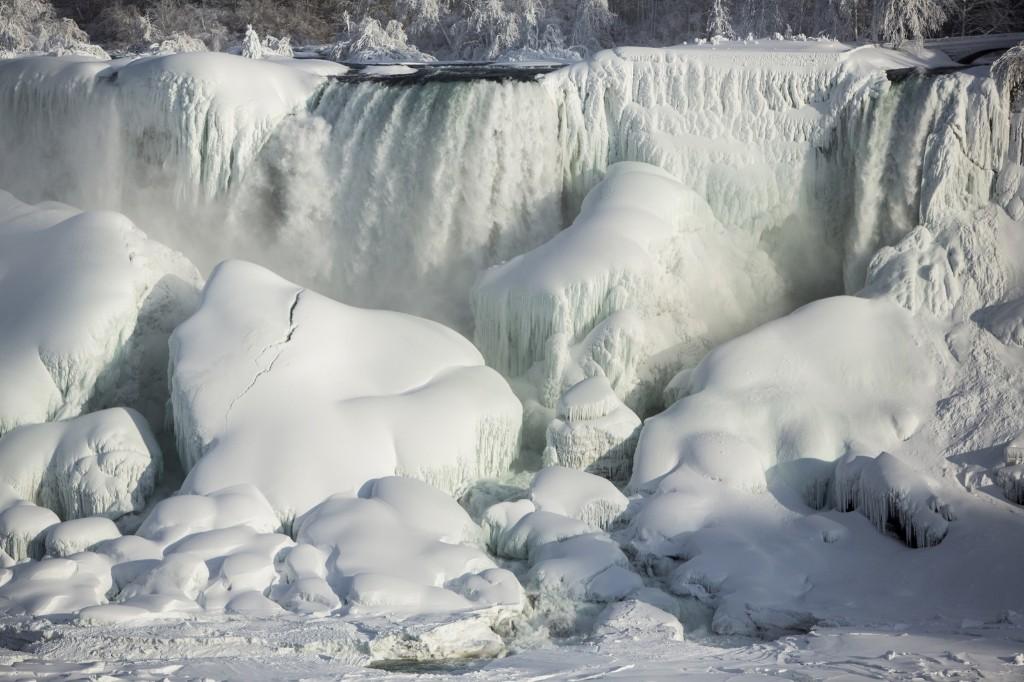 A partially frozen American Falls in sub freezing temperatures is seen from Niagara Falls, Ontario in February, 2015. REUTERS/Lindsay DeDario
