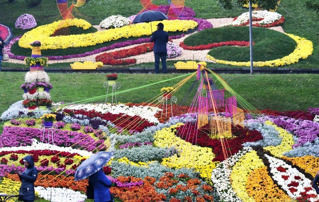 Members of the public visit floral arrangements during the Autumn Melody chrysanthemum festival in Kiev. SERGEI SUPINSKY/AFP/Getty Images