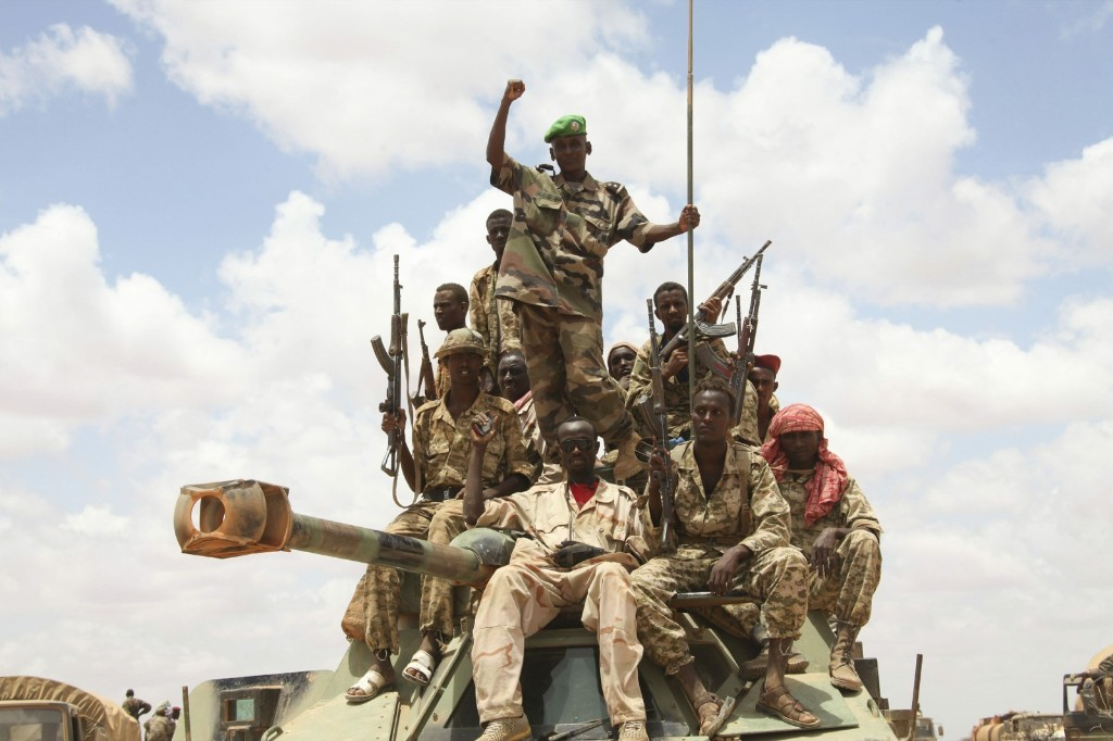 African Union troops celebrate after capturing the al Shabaab-held town of Buule Burde, in the Hiraan region of Somalia. REUTERS/Ilyas A. Abukar