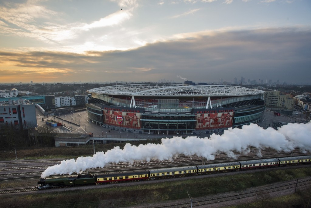 The Flying Scotsman passes Emirates Stadium in London. The majestic steam engine made her way from Kings Cross to York today after being restored to her former glory following a £4.2million revamp. Justin Setterfield/Getty Images