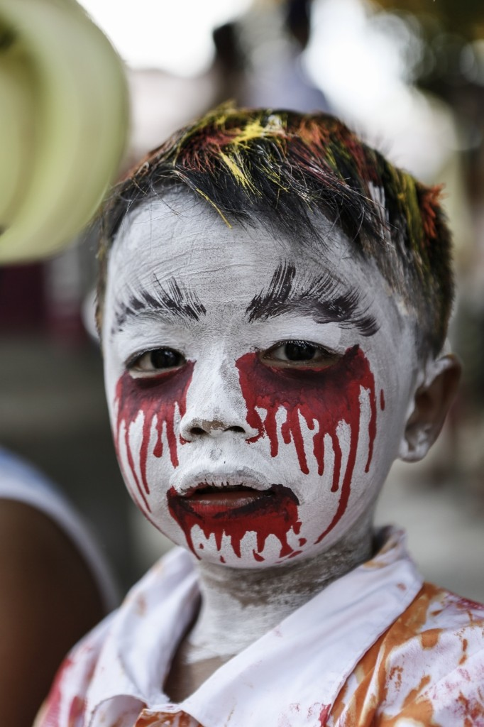 A young boy at the Grebeg Ritual in Tegallalang village, Gianyar, Bali. During the biannual event, young members of the community parade through the village with painted faces and bodies to ward off evil spirits. Putu Sayoga/Getty Images
