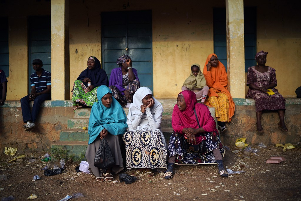 Nigerian voters wait for the scheduled opening of the polling stations in Kaduna, Nigeria, Saturday Feb. 23, 2019. Incumbent President Muhammadu Buhari is to face opposition presidential candidate Atiku Abubakarin in the presidential election. (AP Photo/Jerome Delay)