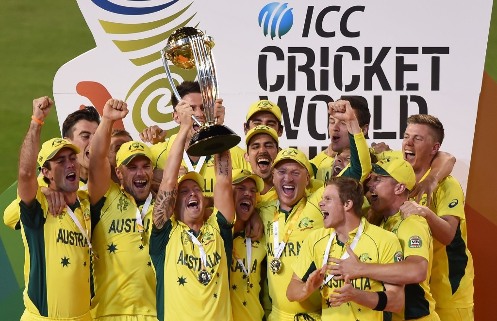 Australian captain Michael Clarke holds the trophy with his teammates as they celebrate their seven wicket win over New Zealand in the Cricket World Cup final, in Melbourne, Sunday. AP Photo/Andy Brownbill