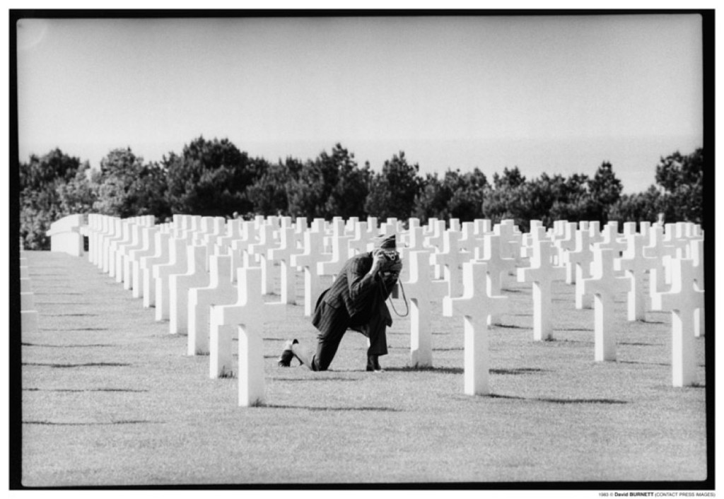 A veteran takes pictures in the U.S. cemetery at Omaha Beach, June 1979. David Burnett/Contact Press Images