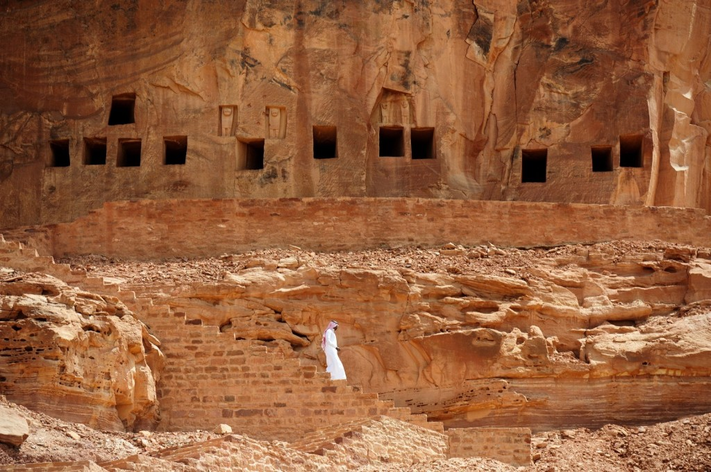 A Saudi man walking near ancient tombs at the Khuraiba archaeological site near Saudi Arabia's northwestern town of al-Ula. Al-Ula, an area rich in archaeological remnants, is seen as a jewel in the crown of future Saudi attractions as the austere kingdom prepares to issue tourist visas for the first time. FAYEZ NURELDINE/AFP/Getty Images