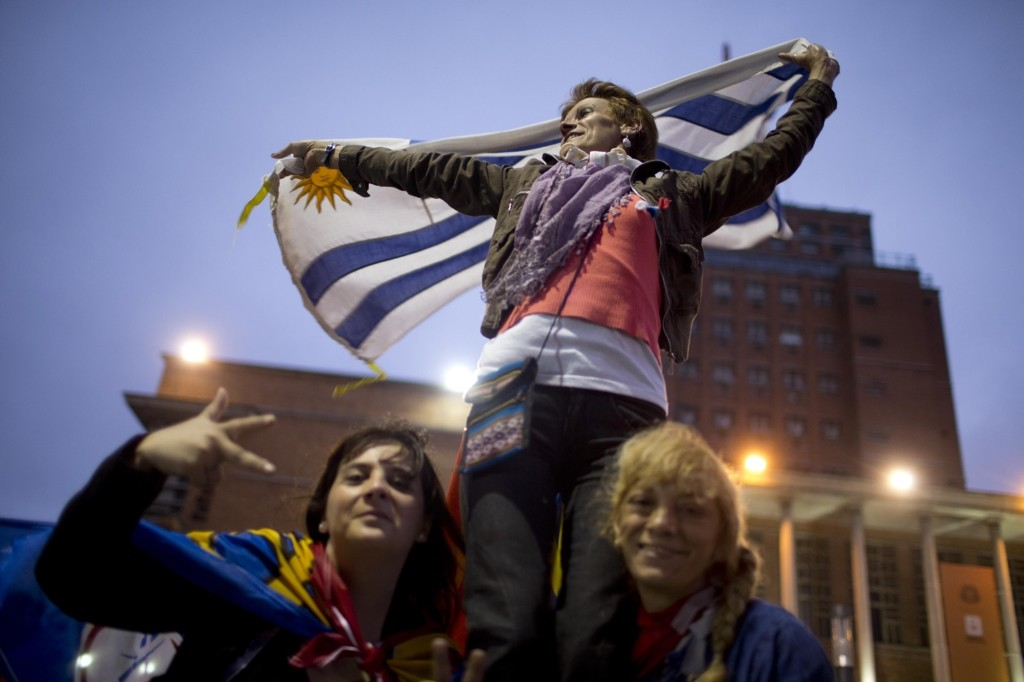 Followers of the ruling Broad Front party celebrate in Montevideo, Uruguay after polls show Tabare Vazquez easily won Uruguay's presidential election. AP Photo/Natacha Pisarenko