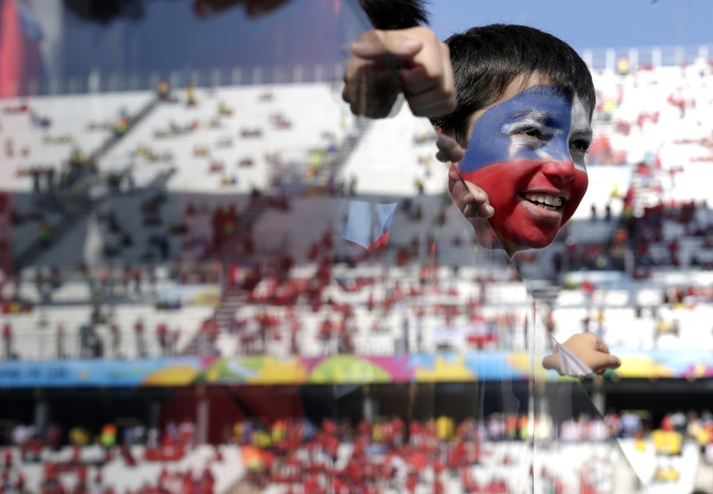 A young Chilean fan before World Cup match between the Netherlands and Chile in Sao Paulo, June 23. AP Photo/Felipe Dana