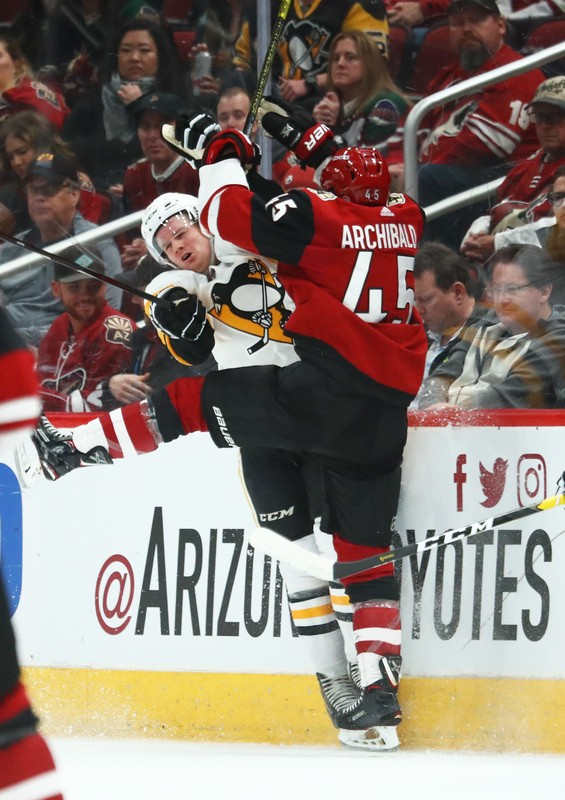 Jan 18, 2019; Glendale, AZ, USA; Pittsburgh Penguins defenseman Juuso Riikola (50) collides with Arizona Coyotes right wing Josh Archibald (45) in the first period at Gila River Arena. Mandatory Credit: Mark J. Rebilas-USA TODAY Sports