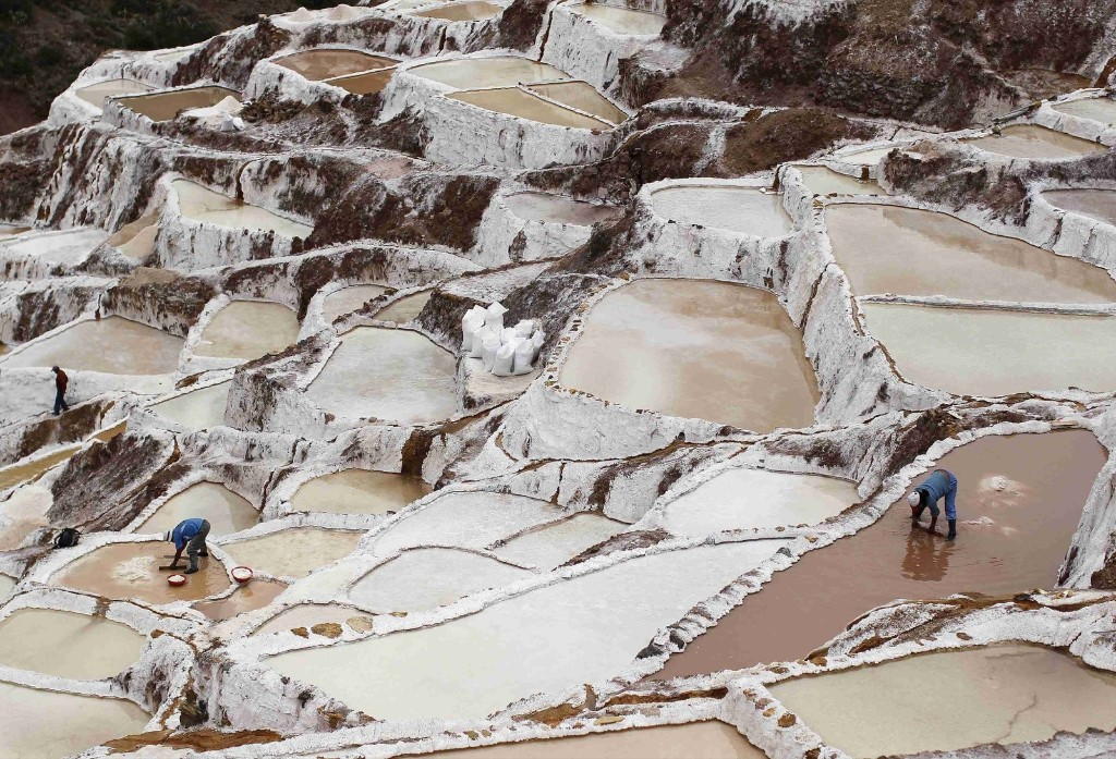 Workers collect salt at the Maras mines in Cuzco, Peru. REUTERS/Enrique Castro-Mendivil