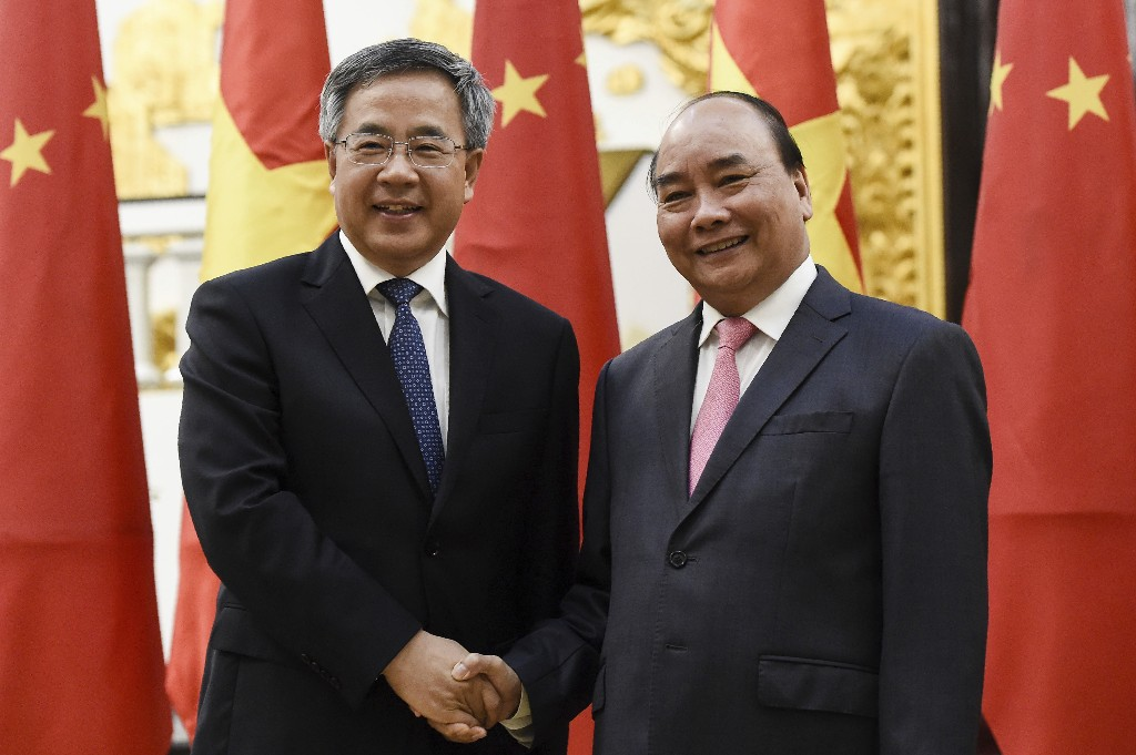 Chinese Vice Premier Hu Chunhua, left, shakes hands with Vietnamese Prime Minister Nguyen Xuan Phuc during their meeting at the Government Office Tuesday, Sept. 11, 2018 in Hanoi, Vietnam. Hu is in Hanoi to attend the three-day World Economic Forum on ASEAN. (Nhac Nguyen/Pool photo via AP)