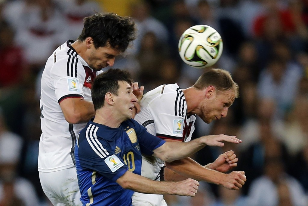 Germany's Mats Hummels, Argentina's Lionel Messi and Germany's Benedikt Hoewedes go for a header. AP Photo/Frank Augstein